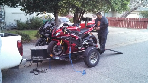 The R6 being loaded up and taken away