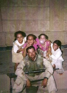 John in Iraq with some local kids.